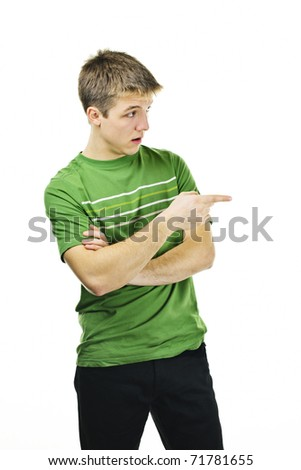 Handsome young man giving directions pointing finger to the side - stock photo