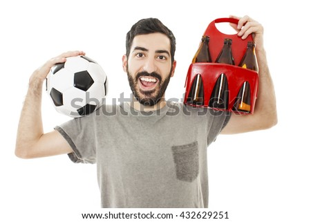 Handsome young man holding ball and pack of beer on white background - stock photo
