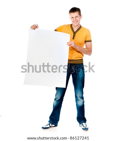 handsome young man holding  big white blank - stock photo