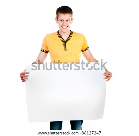 handsome young man holding  big white blank