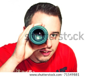 Handsome young man holding camera lens like it was spyglass on white background - stock photo