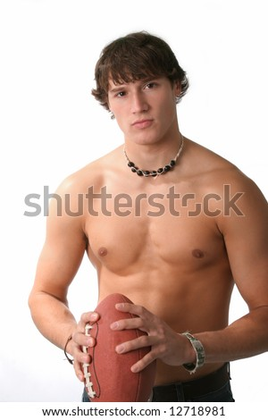 handsome young man holding football