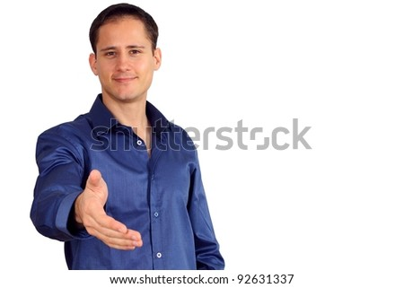 Handsome young man in a blue shirt giving you his hand - stock photo