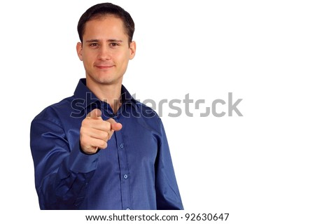 Handsome young man in a blue shirt pointing at you