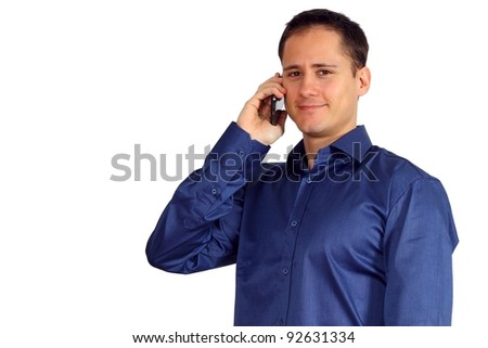 Handsome young man in a blue shirt talking on his smartphone - stock photo