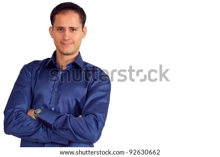 Handsome young man in a blue shirt with his arms crossed - stock photo