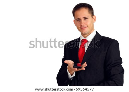 Handsome young man in a suit giving you a smartphone - stock photo