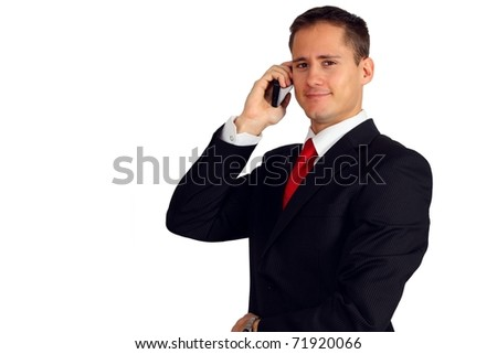 Handsome young man in a suit making a phone call