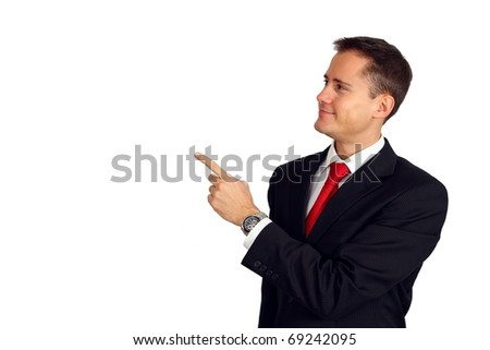 Handsome young man in a suit pointing up and smiling