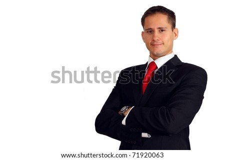 Handsome young man in a suit with his arms crossed - stock photo