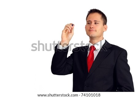 Handsome young man in a suit writing or drawing something - stock photo