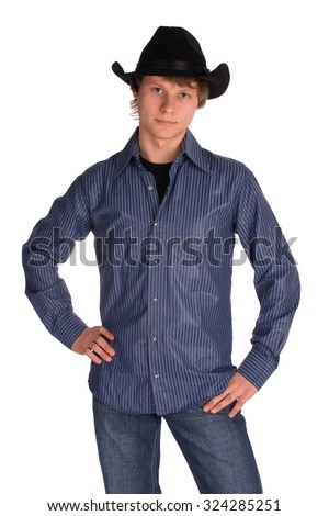 Handsome young man in blue shirt and jeans wearing a hat