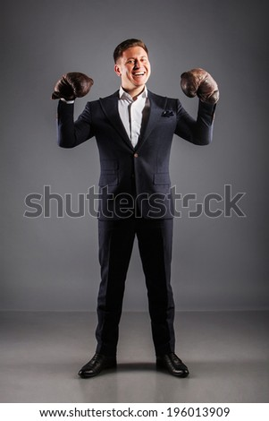 Handsome young man in boxing gloves  all growth - stock photo