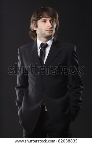 Handsome young man in business suit, studio photo