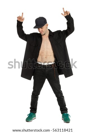 handsome young man in casual clothes dancing modern dance in studio. break dancer isolated on white background. Man posing in studio in casual clothes.