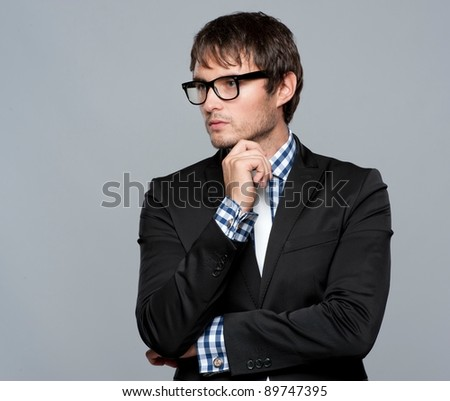 Handsome young man in glasses - stock photo