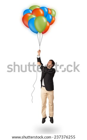 Handsome young man in suit holding colorful balloons