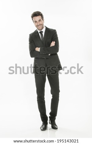 handsome young man in suit posing on isolated background - stock photo