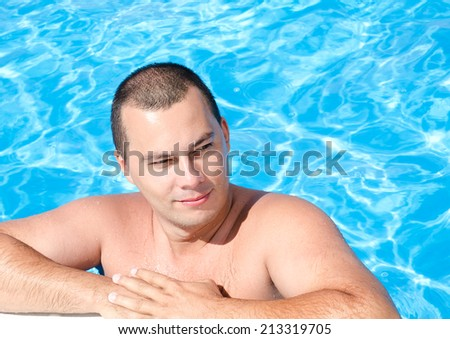 Handsome young man in the swimming pool