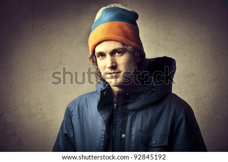 Handsome young man in winter clothes - stock photo