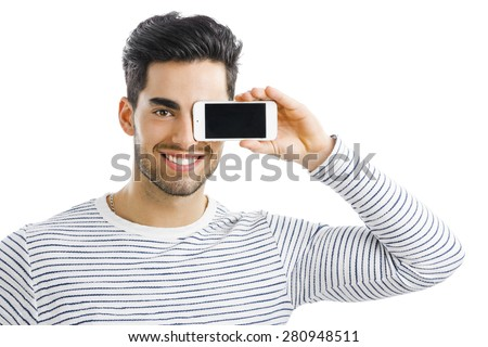 Handsome young man looking and showing something on his phone, isolated on white background - stock photo