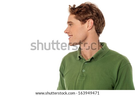 Handsome young man looking away - stock photo