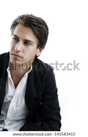 Handsome young man looking away on white - stock photo