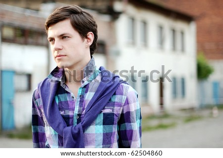 Handsome young man looking to the side - stock photo