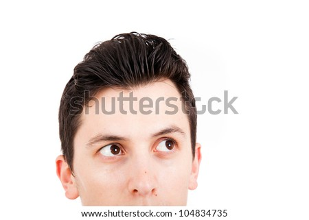 Handsome young man looking up on white background - stock photo