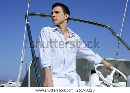 Handsome young man on boat, blue summer vacation outdoor - stock photo