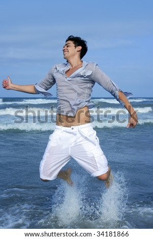 Handsome young man on the blue ocean beach summer sea - stock photo