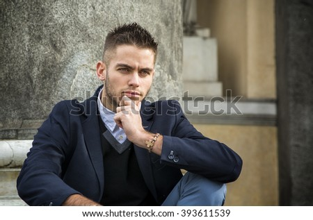 Handsome young man outdoor in jacket and shirt - stock photo