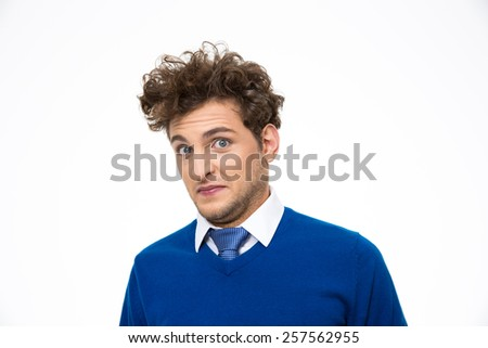 Handsome young man over white background - stock photo