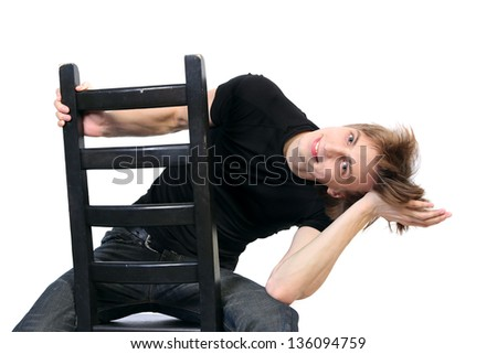 Handsome young  man  playing a fool   sitting on a chair on white background - stock photo