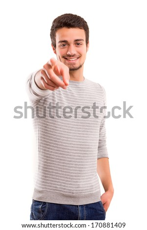 Handsome young man pointing at you, isolated over white background - stock photo