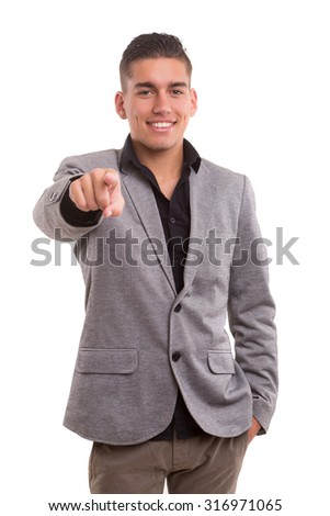 Handsome young man pointing at you, isolated over white background