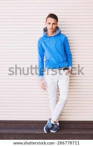 Handsome young man portrait outdoors - stock photo