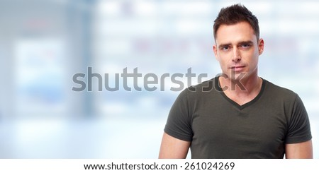 Handsome young man portrait over blue abstract background - stock photo