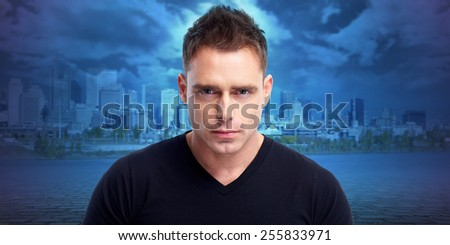 Handsome young man portrait over urban background. - stock photo