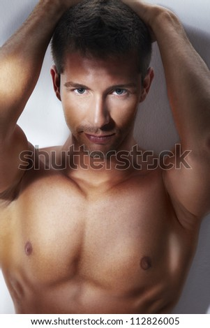 Handsome young man . Portrait with nice light effect. Studio shoot over white background - stock photo