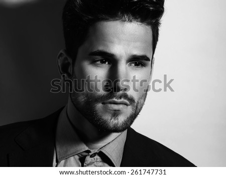 handsome young man posing in business suit - stock photo