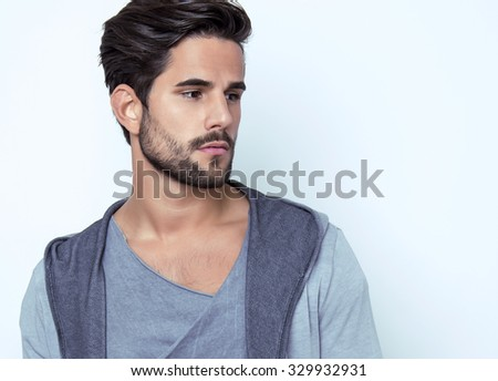 handsome young man posing in casual outfit - stock photo