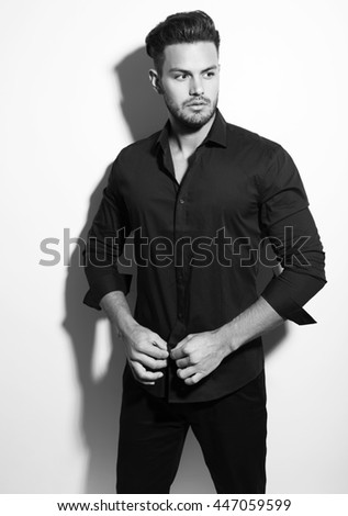 handsome young man posing in dress shirt