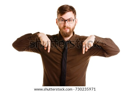 Handsome young man posing in the studio isolated on a white background.
