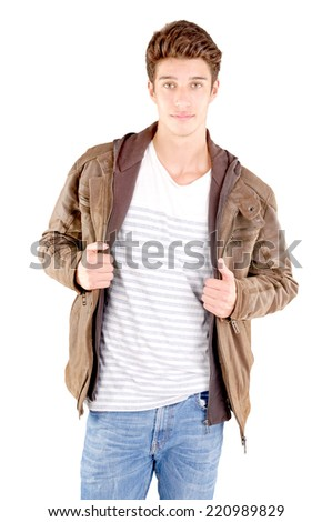 handsome young man posing isolated on gray background - stock photo
