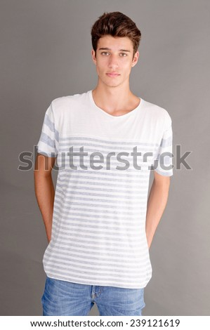 handsome young man posing isolated on gray background