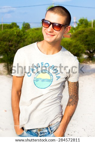 Handsome young man posing on the beach.Travel concept,lifestyle portrait of man working abroad and looking forward.outdoor portrait of man on the beach,attractive,emotional person.traveling man,hiker - stock photo
