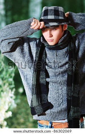 Handsome young man posing outdoor. - stock photo