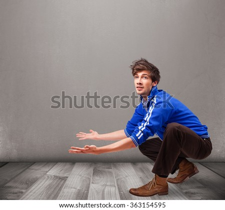 Handsome young man presenting an empty copy space - stock photo