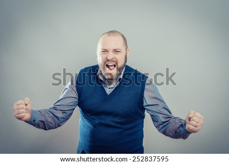 Handsome young man screams  - stock photo